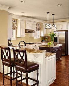 This countertop color/style is what I like with the white cabinets and taupe walls. by delia