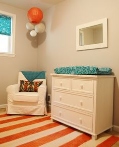 "Changing table and sitting area - and change out the ""balloons"" for a DIY chandelier painted orange...nice!"