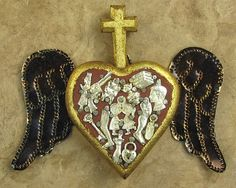 milagro with wings and cross...