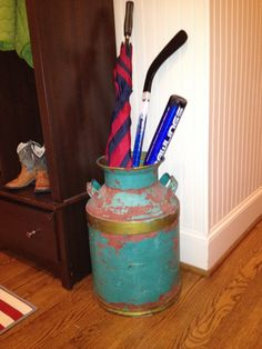Milk Jug used as an umbrella holder in the mudroom.  City Living, Country Life