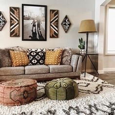 Love these colors together, the wall hanging on each side of a large picture, textures!
