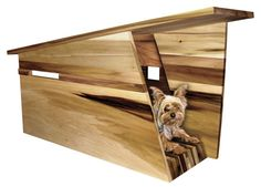 Jesse Doquilo's Mutt dog house (above) is one of my favorite modern dog house designs, and he's come out with a brand new one called Moddy Doggy (last photo). Both houses are priced at $1250 (including shipping). Moddy Doggy will soon be available for purchase online.