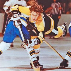 From the HHOF Archives - the legendary Bobby Orr takes flight as he tries to split two defenders.