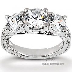 Elegant 3 Stone Man Made Diamond Engagement Ring - 3 stones with 6 small stones 3.15 total carats $1148.00 - http://www.lab-diamonds.com/engagement-rings/single-row-rings/dori-engagement-ring.html
