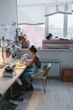 Young woman tailor sewing while sitting at her working place in workshop by Sergey Filimonov - Stocksy United Sewing Room Design, Sewing Spaces, Sewing Studio, Sewing Rooms, Workspace Inspiration, Room Inspiration, Workshop Design, Workshop Studio, Ideias Diy