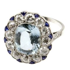 Belle Époque Aquamarine Target Ring with Diamonds and Sapphires. Circa 1910.