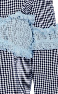 This **Sandy Liang** Disco Gingham Ruffle Shirt features a standard collar with contrast ruffle bodice detail and a straight silhouette.