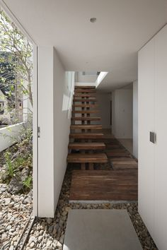 floating stairs with Japanese aesthetic. I also love the pebbles framing the area in the foreground