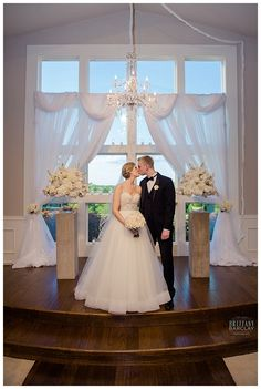 Bride and Groom in ceremony room at Milestone Krum Wedding by brittanybarclay.com