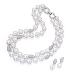 18 KARAT WHITE GOLD, CULTURED PEARL AND DIAMOND NECKLACE AND PENDANT-EARRINGS The double-strand necklace composed of 50 baroque cultured pearls measuring approximately 17.2 by 19.8 mm to 12.6 by 13.0 mm, accented by round diamonds weighing 17.00 carats, length 19¼ inches; together with a pair of pendant-earrings set with round diamonds weighing 2.65 carats, suspending two cultured pearls measuring approximately 14.2 by 15.0 mm and 14.5 by 15.1 mm; pendants detachable.