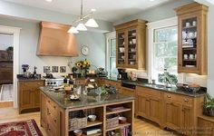 White window frames with oak cabinets. I like the soft gray and white cooling down the heavy wood of the cabinets. Could work in the kitchen...