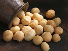 Macadamia nuts are a nutritious food with many potential benefits, including lowering the risk of heart disease and possibly helping prevent cancer. Learn more about the benefits of macadamia nuts, as well as some drawbacks to be aware of, here. Appetizer Recipes, Snack Recipes, Snacks, Appetizers, Chocolate Nutrition, Cancer Fighting Foods, Raw Food Diet, Raw Vegan Recipes, Vegan Foods