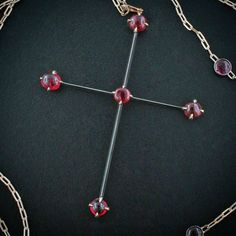 Taffin Jewelry. Steel, gold and cabochon spinel cross
