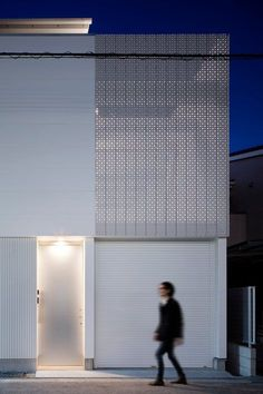 Architect Yoshiaki Yamashita�s adopted for three-story Light Grain House a perforated #facade which allows natural light to shine through while balancing air circulation #Japanese #architecture