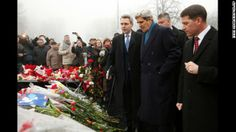 U.S. Secretary of State John Kerry, wearing a blue scarf, visits a shrine Tuesday, March 4, for the people who were killed during anti-government protests in Kiev, Ukraine, last month.