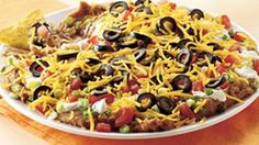 This easy Southwestern recipe favorite features the flavors of ranch dressing, onions, tomatoes, peppers, and olives, just to name a few. 16 servings (1/4 cup dip and 1 oz chips each)