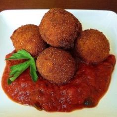 Italian Ricotta Fritters - little balls of cheese, prosciutto and herbs, rolled in crumbs and fried. Served with marinara.