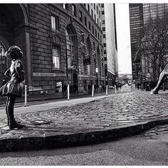 "Fearless Girl : Wall Street NYC. The firm State Street Global Advisors who put the statue facing the bull in the wee hours of night to highlight International Women's Day sure does know how to send a powerful message! And the CEO is a man says even more I think.... A PR rouse? Whatever it may be - it's pretty damn great! The inscription at the base reads ""Know the power of women in leadership. She makes a difference."" #kristenvisbal #artist #feminism #teachyourchildren #standtall #women…"