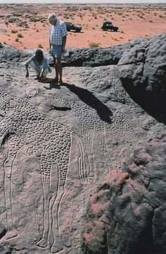 On an island of stone in the wind-tossed Sahara, a pair of monumental giraffes exalt the unknown artist who carved them thousands of years ago. National Geographic, September 1999.