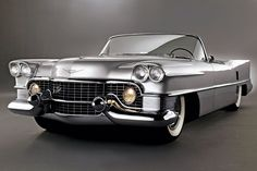 With its muscular egg-crate grille, dramatically curved windshield, quad headlights, and angular tail fins, the '59 Le Mans was the epitome of Cadillac's tough-guy elegance.