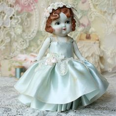 sweet antique bisque doll- have one- in Tracy's little china cabinet