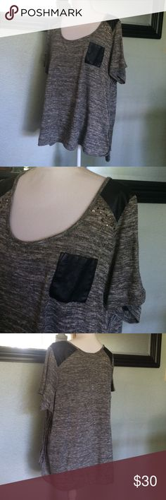 Lane Bryant top Fun top by Lane Bryant. Faux leather pocket and shoulders. Fun metal studs at shoulders. Color is gray black with gold threading for a fun extra shimmer. This top is so cute!! Size 22/24. Bit of wear at neck but not noticeable when worn! Lane Bryant Tops