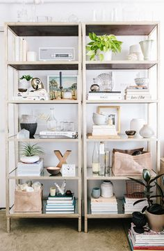 Looking for a new way to style your bookshelves? Setting two identical shelves next to each other will help mimic the look of built-ins, and give you more space to arrange your favorite accessories.