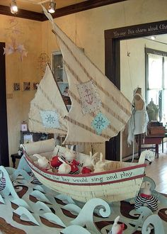 Recycled cardboard boat, cut paper waves, handmade...sail away. # paper, recycle, paint, handcrafted
