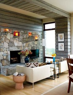 """I love the niches in this dry-stacked stone fireplace from Craft1945.  Also love the reclaimed wood along the wall and ceiling - it adds a rustic element without screaming """"log cabin""""."""