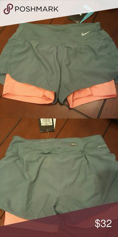 d22ae19bd771 NWT Nike women s perforated rival 2 in 1 shorts Dry fit running shorts with  a zip in the back. Blue gray Delusional about what size I wear when buying.