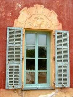 Nice, France / colorful walls, old shutters and trompe-l'oeil arch