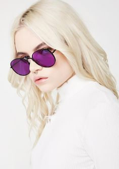Got Grapez Stunna Shades 'cuz ya got the purple. These rad sunglasses have sikk purple and oval lenses with a wire frame and nose guard to keep 'em in place while you turn up.