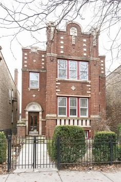 traditional red brick 3 flat apartment building in ukrainian village