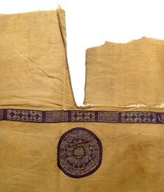 """Coptic tunic, Egypt, c. 4th - 5th Century AD, linen and wool, DETAIL, with hemmed neck or under arm slit above a long intricate band decorated with alternating geometric devices. Below is a large orbiculus with a very beautiful and intricate interlocking geometric motif. 42"""" x 15 3/4"""" (106.4 x 39.4 cm)."""