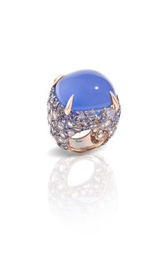 Pomellato Pom Pom griffe ring featuring a chalcedony surrounded by tanzanites and diamonds.