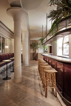 Design studio Space Copenhagen has combined a classic brasserie with a courtyard feel in its design for a restaurant in the heart of Copenhagen.