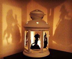 Create a magical atmosphere in your little princess's bedroom by turning on this Beauty and the Beast shadow lantern. The glass sides are decorated with vinyl character cutouts that project their likeness onto the nearby walls.