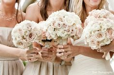 The bridesmaids will carry bouquets of pale pink and ivory spray roses wrapped in natural burlap with the stems showing.