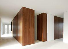 Monolithic marble partition divides Antwerp penthouse