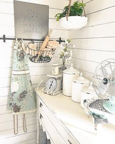 Isn't this is a beautiful nook w pops of spring-fresh flair? Love colorful apron, the rolling pin and pretty flowers staged in our Hanging Wire Basket too! #homedecor