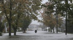 A lone figure makes his way down Seventh Street in Lindenhurst, New York, on Monday.
