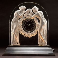 Art Glass:Lalique, R. LALIQUE CLEAR AND FROSTED GLASS DEUX FIGURINES CLOCK .Circa 1926. Wheel carved: R. LALIQUE, FRANCE. 14-5/8 i...