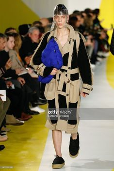 A model presents a creation by Maison Margiela during the men's Fashion Week for the Fall/Winter 2018/2019 collection on January 19, 2018 in Paris. /