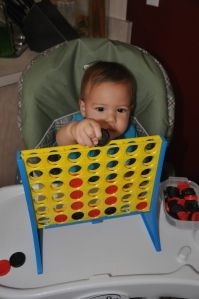Independent activities for 1 year old: balls, sticky table, musical pots/drum, cardboard tunnel, busy board, connect 4, water paint, empty baskets, open jars and lids,