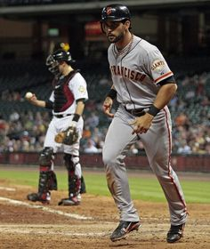 Angel Pagan #16 of the San Francisco Giants scores in the fifth inning against the Houston Astros on August 30, 2012