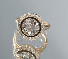 Gorgeous vintage art deco engagement ring with black enamel.