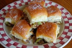 Philly Cheesesteak Sliders - Buttery Hawaiian buns, filled with tender pieces of steak, sautéed onions and peppers, and melted provolone cheese.