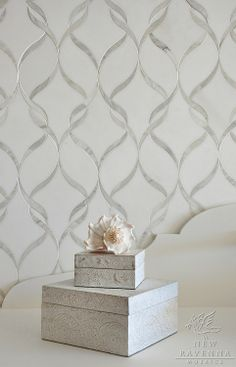 Sophie, a natural stone waterjet mosaic shown in polished Calacatta Tia  and honed Thassos, is part of the Silk Road Collection by Sara Bald...