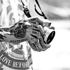 Hand + finger tats + camera