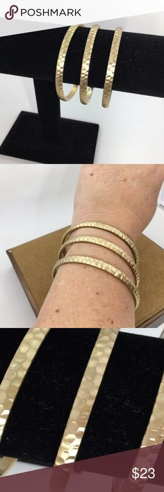 """🆕 Three Metallic Gold Bracelets Three metallic gold bangle bracelets from Macy's. Excellent quality. Opening is 2 7/8"""" & 1/4"""" wide. In excellent like new condition with NO damage. Jewelry Bracelets"""